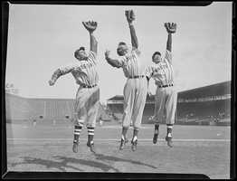(L to R:) Boston Red Sox Bobby Doerr, Ted Williams, and Dom DiMaggio show their reach at Fenway Park ca. 1940.