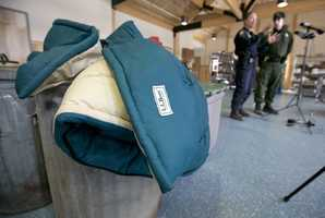 In the 47-year-old's camp, they recovered goods that included high-end L.L. Bean sleeping bags and a new tent.
