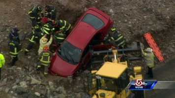 A car drove over an embankment at a construction site on Route 128 in Dedham on Friday.