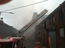 The fire broke out just before 7 a.m., in the brick, multi-story commercial buildings on Norfolk Avenue.