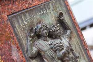 A close-up look at one of the four stone markers at the finish line for the Boston Marathon in Copley Square.