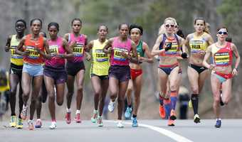 Elite female marathoners, front row from left, Rita Jeptoo, Mamitu Daska, Meserat Debele, Tirifi Beyene, Alemitu Begna, Shalane Flanagan, Ana Felix and Sabrina Mockenhaupt compete on the course in Wellesley