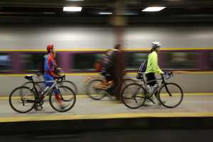 Monty Montana, left, walks his bicycle across the platform at South Station in Boston. Cyclists met at South Station to take a special train to Hopkinton, Mass. They biked the entire Boston Marathon route, from Hopkinton to Copley Square the night before the Boston Marathon.