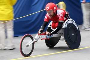 Rafael Botelle Jimenez crosses the finish line of the Boston Marathon after he completed the Men's Wheelchair race.