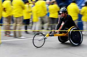 Aaron Pike, of Champaign, Ill., completes the Boston Marathon in Copley Square, coming in 19th place in the Male Open Wheelchair race. Pike competed in the 2009 Boston Marathon and the 2012 Paralympic Games in London.