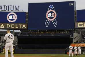 New York Yankees players observe a moment of silence in memory of the victims of the Boston Marathon explosions