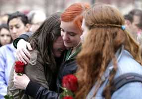 Emma MacDonald, 21, left, is comforted by Rachael Semplice, 22, center, as Juliana Hudson, 23, looks during a vigil for the victims of the Boston Marathon explosions at Boston Common.