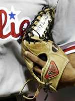 Philadelphia Phillies center fielder Ben Revere runs off the field with tape on his glove that says 'Pray for Boston,' for the victims of the Monday bombings at the Boston Marathon, in the fifth inning of a baseball game against the Cincinnati Reds in Cincinnati.