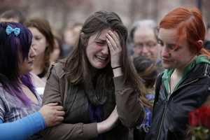 Emma MacDonald, 21, center, cries during a vigil for the victims of the Boston Marathon explosions at Boston Common.