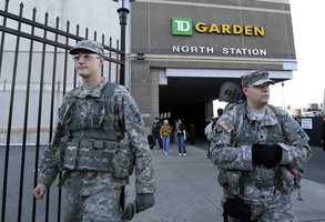 United States soldiers walk outside TD Garden before a Boston Bruins hockey game against the Buffalo Sabres in Boston, in the aftermath of Monday's Boston Marathon bombings.