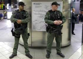 Transit police stand near the entrances to TD Garden