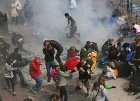 This photo provided by Ben Thorndike shows the scene following an explosion at the 2013 Boston Marathon in Boston. Two explosions shattered the euphoria of the Boston Marathon finish line on Monday, sending authorities out on the course to carry off the injured while the stragglers were rerouted away from the smoking site of the blasts.