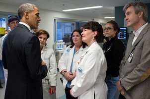 President Barack Obama talks with staff at Massachusetts General Hospital in Boston
