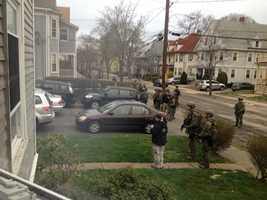 Police conduct door-to-door search in Watertown