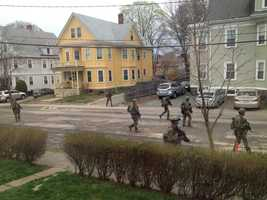 Police conduct door-to-door searches in Watertown