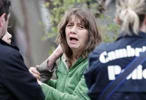 An unidentified resident of Norfolk Street in Cambridge, Mass., talks with police, Friday, April 19, 2013.