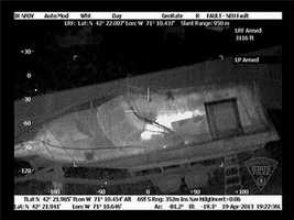 The Massachusetts State Police released this photo of the boat in the backyard of a Franklin Street home in Watertown, taken during the arrest of bombing suspect Dzhokhar Tsarnaev.  The photo appears to show Tsarnaev hiding in the boat.