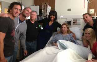 This April 18, 2013 photo provided by Alfred Colonese shows from left Alfred Colonese, Mick Henn, Dale Abbott, first lady Michelle Obama, Heather Abbott, Jason Geremia, and Michelle Dalrymple at Brigham and Women's Hospital in Boston. Heather Abbott was scrambling to get off the sidewalk when the force of the second blast blew her through the restaurant doorway. The day of the bombings, Abbott and a half-dozen friends took in the traditional Patriots' Day Red Sox game at Fenway Park. They left the match early and headed to Forum, where former New England Patriots were gathered to raise money for offensive guard Joe Andruzzi's cancer foundation, and where another friend was tending bar.