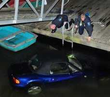 A man drove his BMW off a dock, and the car plunged into the Cohasset Harbor.