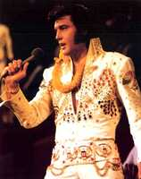 """Jan. 14, 1973 - Elvis Presley's """"Aloha From Hawaii Via Satellite"""" television special is broadcast in over 40 countries around the world.The first worldwide telecast by an entertainer watched by more people than watched the Apollo moon landings."""