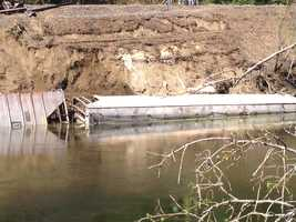 Officials are planning to retrieve three freight train cars carrying corn that plunged into the Passumpsic River after derailing on the Comerford Dam. No one was hurt in Monday night's incident.