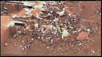 The storm laid waste to scores of buildings in Moore, south of the city.