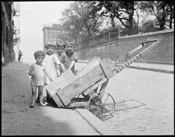 Circa 1930: North End children cool off with ice cart on Copp's Hill
