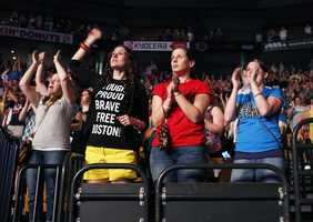 Concert goers watch the Boston Strong Concert: An Evening of Support and Celebration at the TD Garden