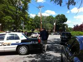 Police and members of the bomb squad surrounded a home on Elm Street in Woburn Wednesday.