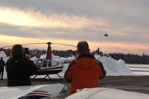 Jake's father, Neil Rabideau, takes photos of his son's first solo flight