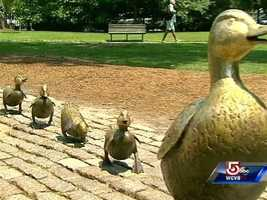 "Robert McCloskey's ""Make Way for Ducklings"" are immortalized in bronze in the Boston Public Garden."
