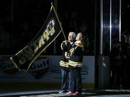"William and Patricia Campbell, parents of Krystle Campbell, who was killed in the Boston Marathon bombings, wave a ""Boston Strong"" banner before Game 4 in the Eastern Conference finals of the NHL hockey Stanley Cup playoffs between the Boston Bruins and the Pittsburgh Penguins, in Boston on Friday, June 7, 2013."