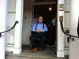 Boston Mayor Tom Menino watches the parade from outside the Parkman House where he is still recovering from recent surgery for prostate cancer.