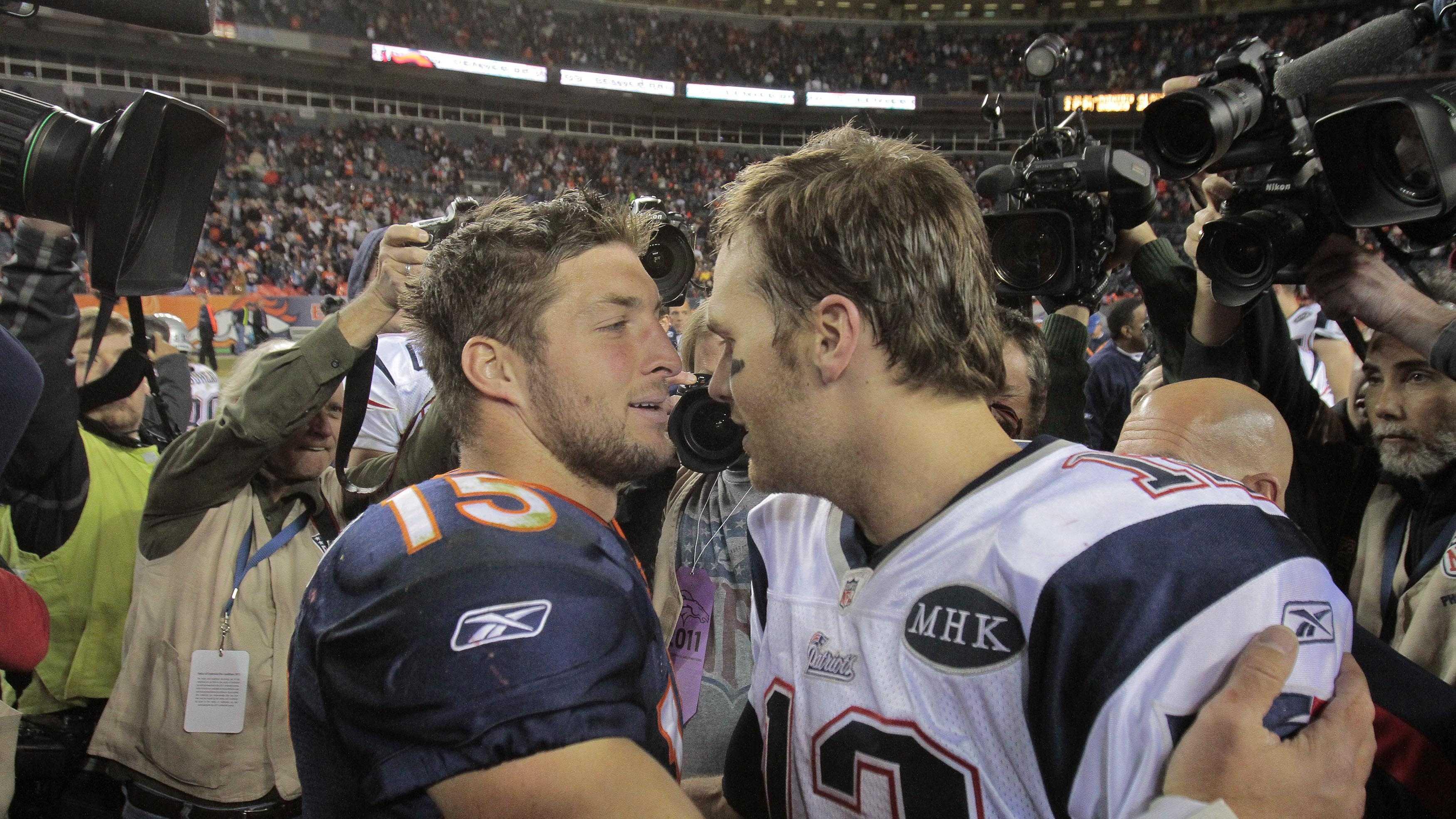 Tim Tebow with Tom Brady