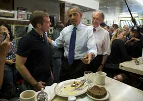 Obama was accompanied by Democratic Massachusetts Senate candidate, Rep. Ed Markey, as they greeted patrons.