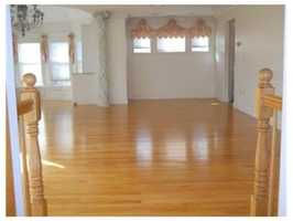 The home has gleaming hardwood floors.