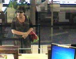 Security camera photo of a woman who robbed the Eastern Bank on Franklin Street in Quincy on Wednesday, June 26, 2013.