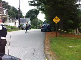 A man was shot and killed by police in Ashland on Tuesday as officers were serving a warrant.