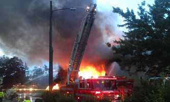 A fast-moving fire destroyed two homes and several vehicles in a Springfield neighborhood early Wednesday morning.