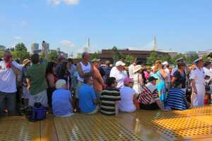 Special guests and VIP members enjoy the view as the USS Constitution heads to Castle Island.