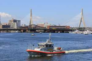 Numerous U.S. Coast Guard boats and fire vehicles cleared the path for the USS Constitution's voyage through Boston Harbor.