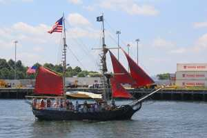 """Dozens of boats, including this historic looking pirate ship were located around """"Old Ironsides"""""""