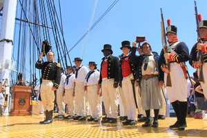 The solemn salute from former and active members of the Navy during the 21-gun salute on the USS Constitution.