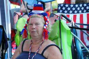 Concert-goers braved scorching temperatures as they waited all day for the show to begin, but still wore their patriotic garb.