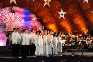 "The Tanglewood Festival Chorus performs during the ""1812 Overture"""
