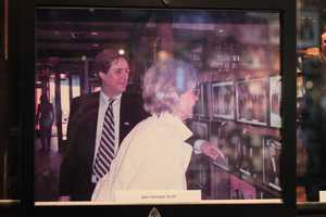 A picture of a picture: Michael Athanas showed Jean Kennedy Smith photographs on the wall of the lobby