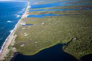 The property is surrounded by ocean and conservation lands