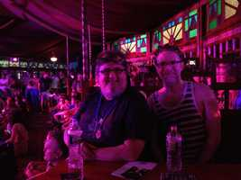"Fans inside the Spiegeltent enjoying an interactive performance of ""The Bacchae."""