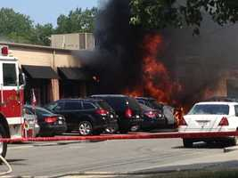 Fire destroyed at least two vehicles outside a Newton business Tuesday afternoon.