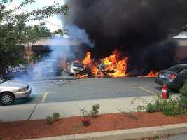 Newton firefighters say the SUV gas tank caught fire - causing the fire to spread in the parking lot.
